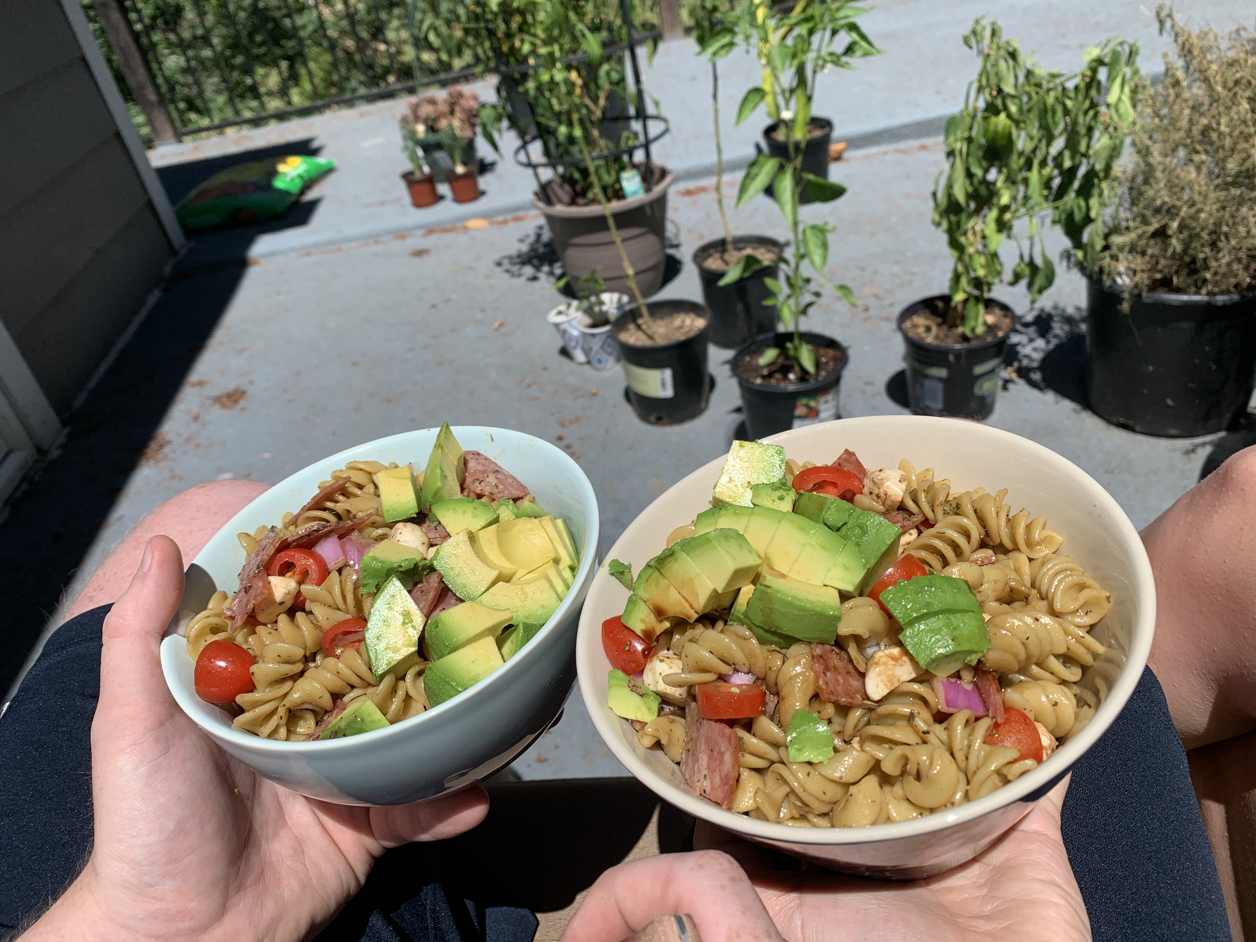 Will and Alexx enjoying homemade pasta salad on Will's deck